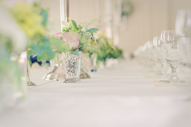 Southern wedding tablescape decorated with mint julep cups filled with flowers