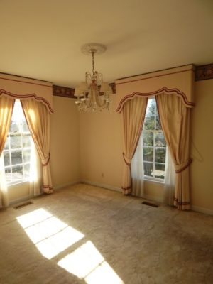 Original dining room in our house painted in cream with burgandy wallpaper border and heavy curtains