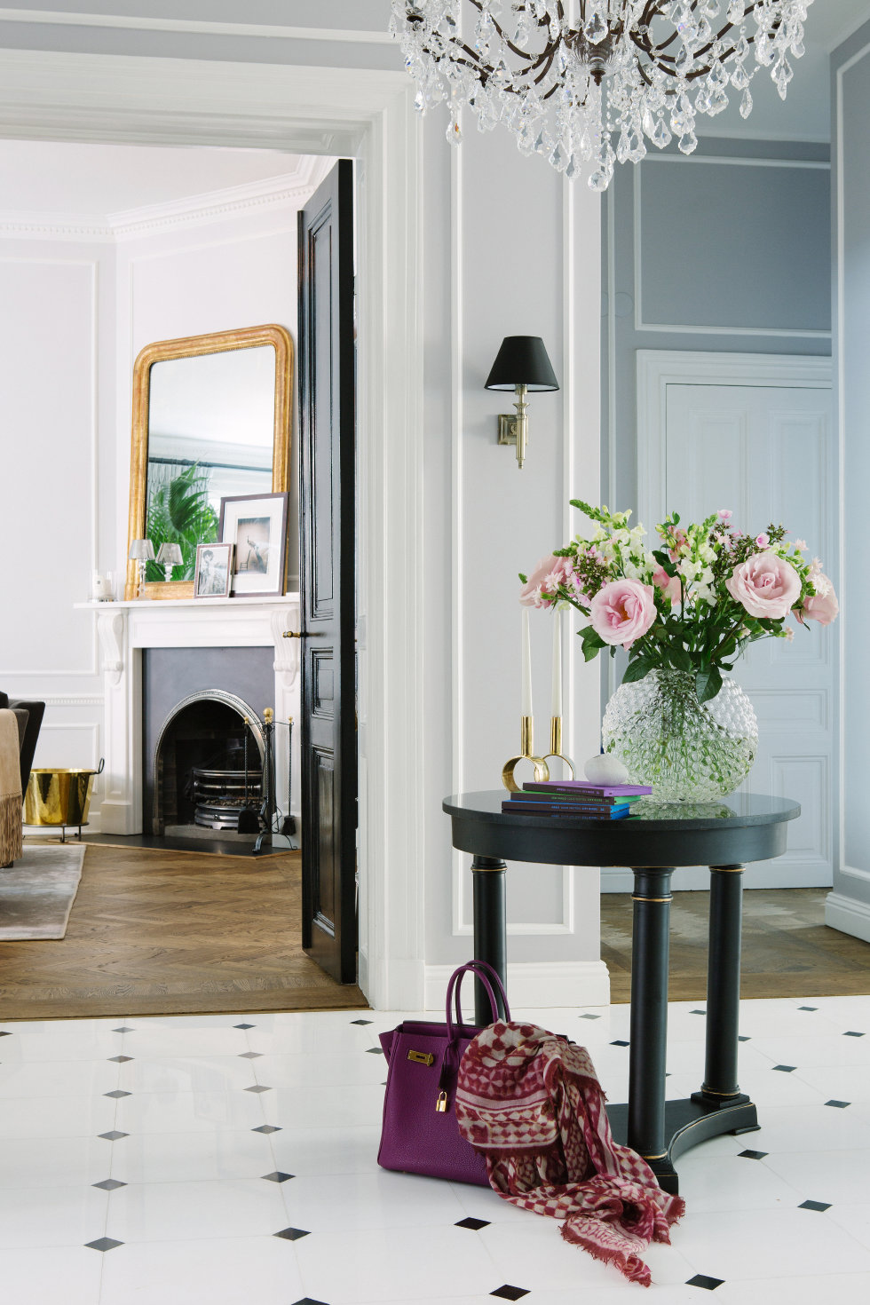 I love the round entry table and black and white theme in this photo from This is Glamorous.