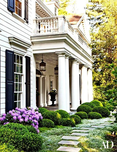 I'm inspired by the landscaping and portico shape. Image via Splendor in the South