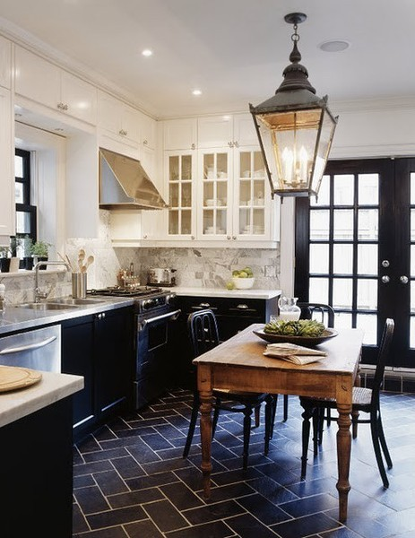 Loving the two toned cabinets plus rustic farm elements with the stainless steel from designer Tommy Smythe.