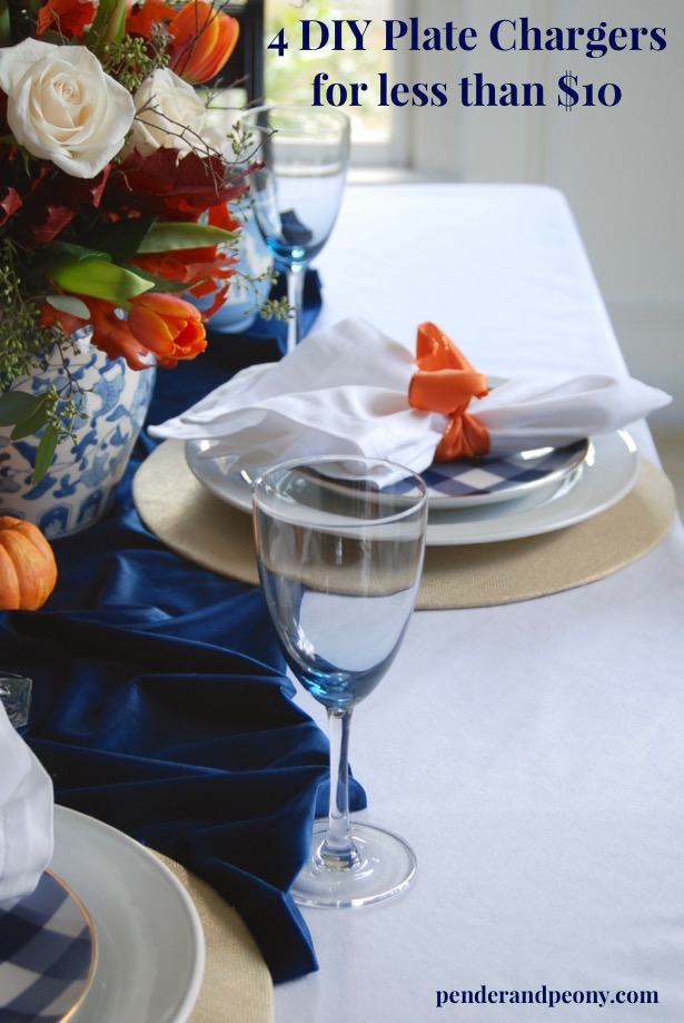 Fall tablescape in blue and white with orange tulips and DIY plate chargers made of fabric.