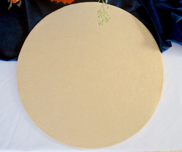 gold fabric DIY plate charger on blue and white autumn table.