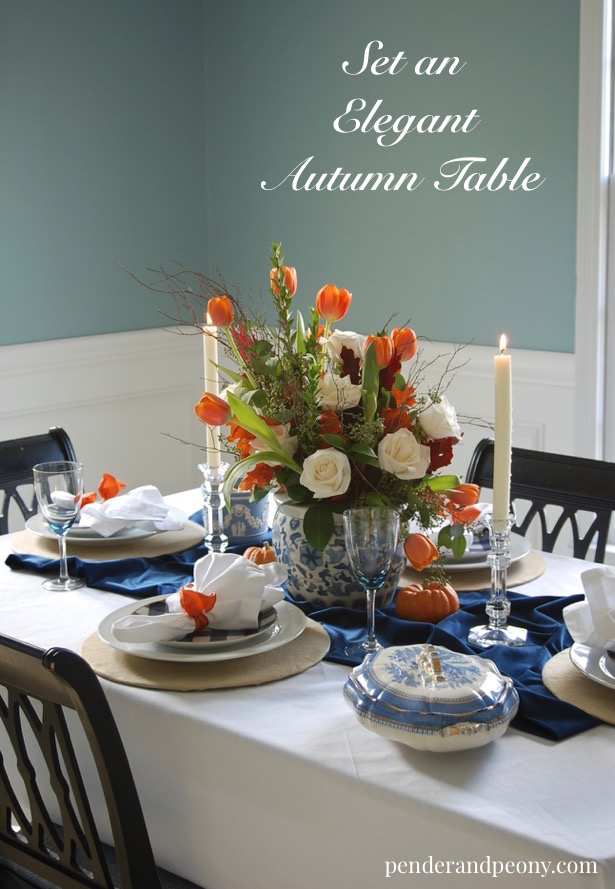 Set an elegant autumn table with this blue and orange color palette. Learn tips to make your fall tablescape gorgeous.