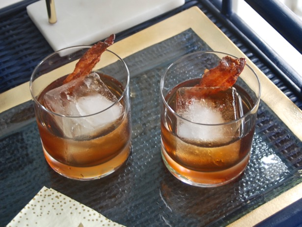The perfect Thanksgiving cocktail - a maple bourbon cocktail with candied bacon