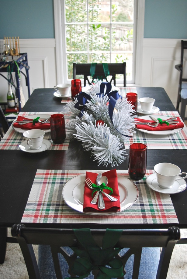 Set a festive table for your Christmas brunch party with plaid placemats, splashes of red, and winter greenery!