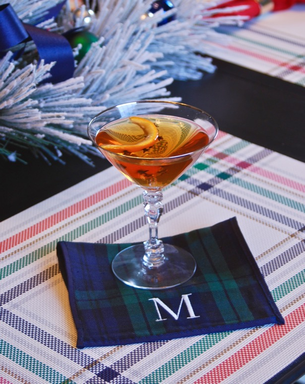 Sit by the fire and enjoy all the tastes of Christmas in this holiday martini made with bourbon, amaretto, and vanilla clove syrup.