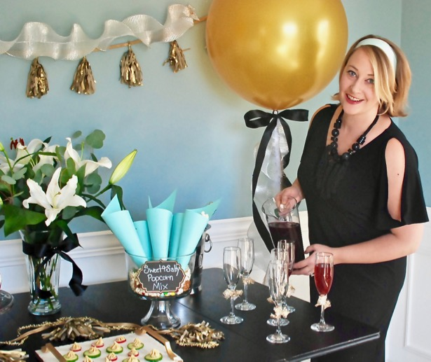 Invite girlfriends over for a glamorous Golden Globes party. Get inspired with these party ideas featuring DIY popcorn cones, gold balloons, and tassel garland.