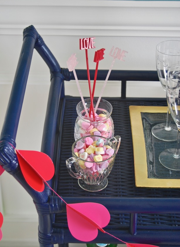 Valentine's bar cart with conversation heart decor
