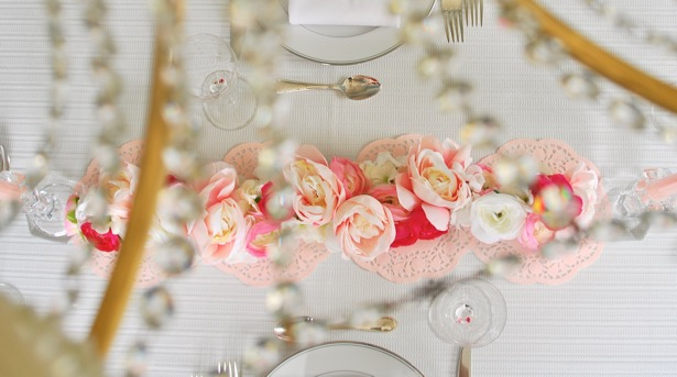 Celebrate your gal pals this weekend with this inspirational Galentine's Day Brunch tablescape + bar cart! Decorate in pink and white with a gorgeous floral garland and fun conversation hearts.