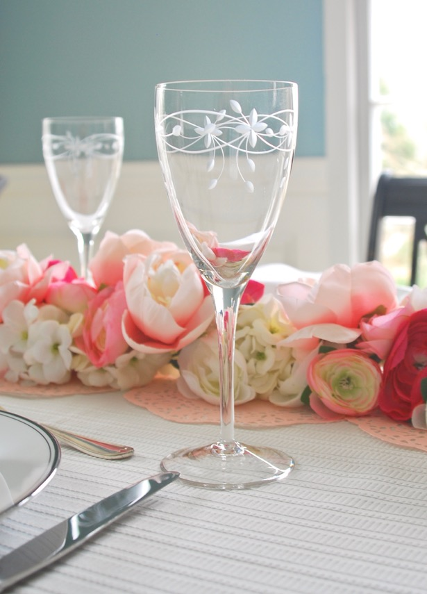 Galentine's Day brunch tablescape + bar car with faux floral garland in pink and white.