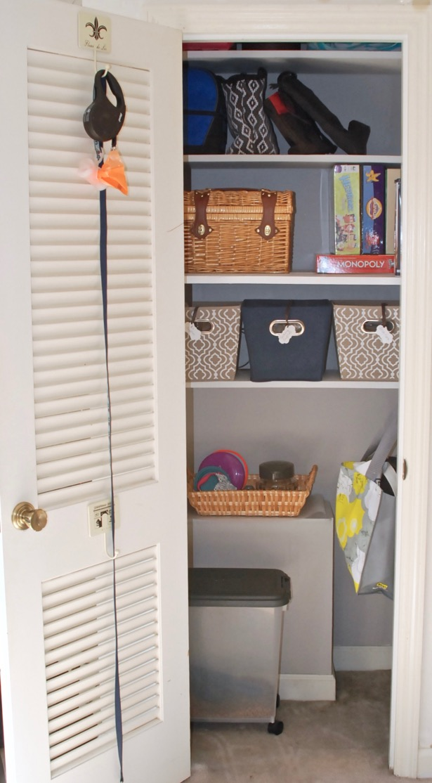 Entryway closet organized with added shelves and bins