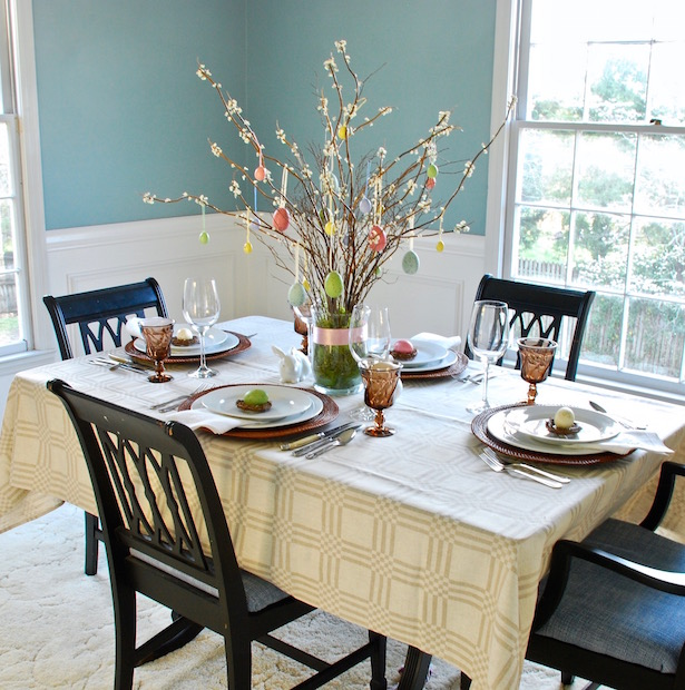 Set a sophisticated Easter table with pastel details and rustic elements.