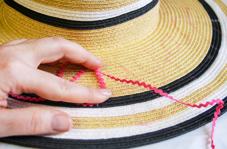 A little bit sassy, a whole lot of Southern this DIY rick-rack script sun hat is perfect for lazy days at the beach or pool!
