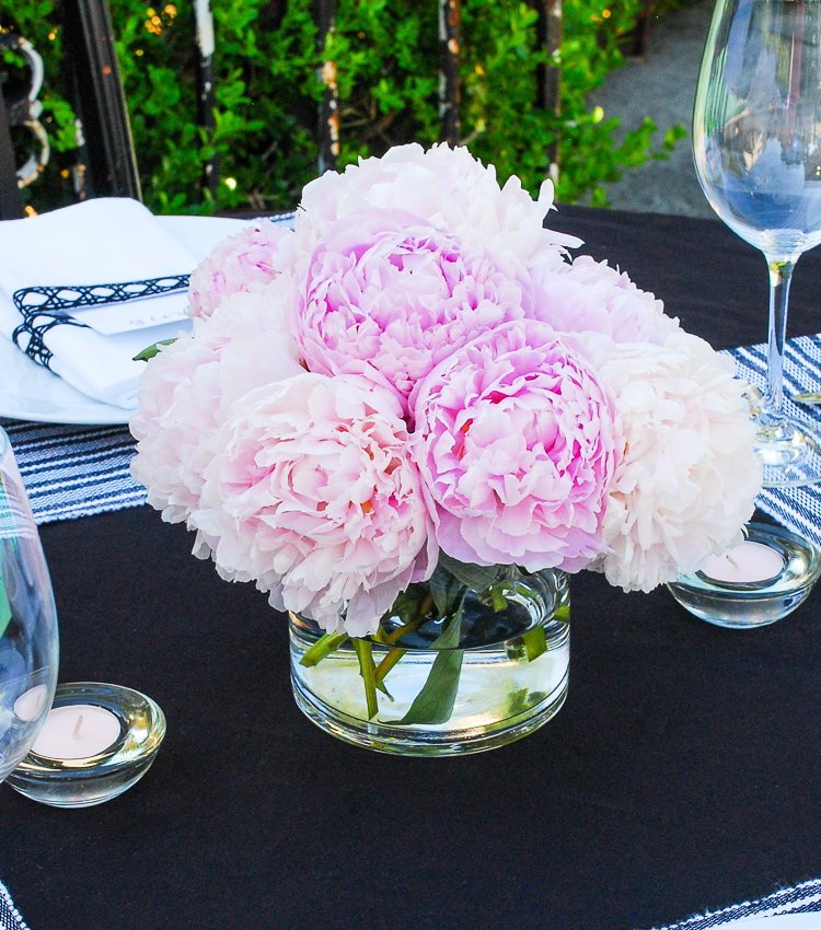 Peonies always make a beautiful tablescape. Follow these 3 rules to host a noteworthy summer dinner party filled with good conversation, delicious food, and plentiful libations.