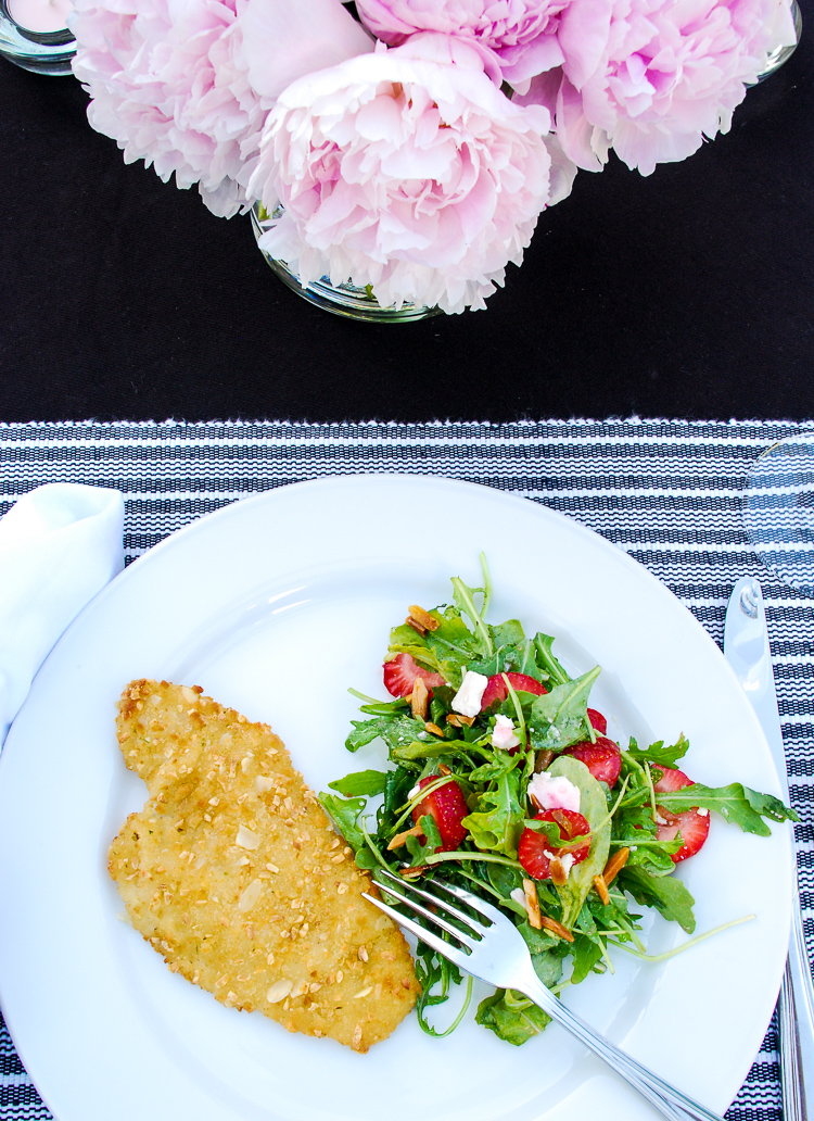 Almond crusted flounder with a strawberry arugula salad are sure to please summer party dinner guests.