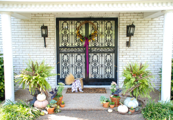 Elevate your curb appeal by adding autumn charm at the front door with punches of purple, heirloom pumpkins, terra cotta pots, fall plants, and festive ferns.