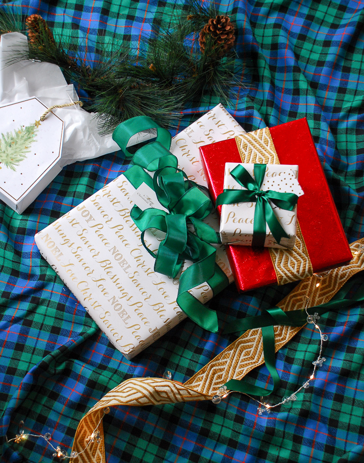Christmas presents on plaid background. Holiday hosting hacks - make presents double as decor