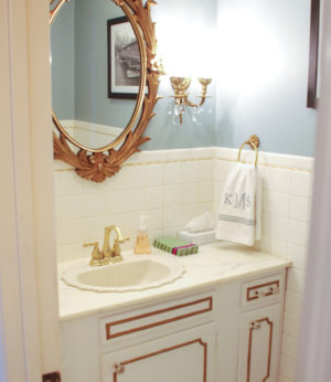 Check out our simple powder room makeover! With a coat of paint and some serious scrubbing we made quite the transformation!