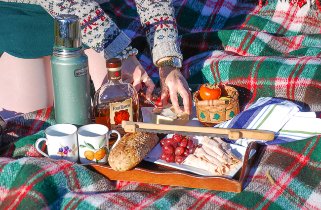 Throw down a wooly plaid blanket and pour the apple cider for a lovely November picnic on the tree farm.