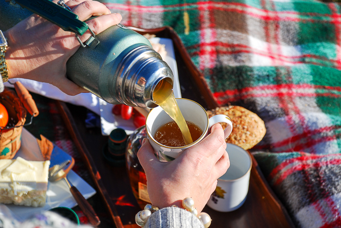 Make this apple cider hot toddy with pineapple and bourbon for a party punch. Another great holiday hosting hack!