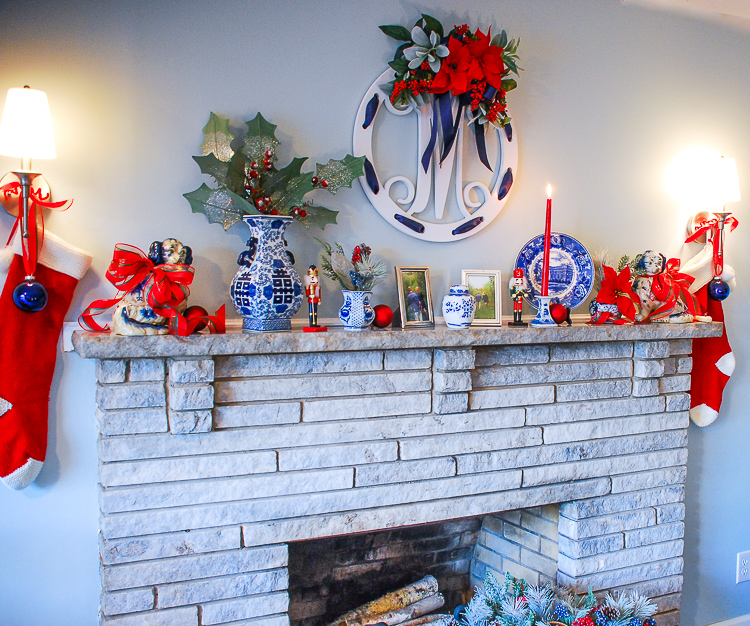 Transition your blue and white mantel decor from fall to Christmas in just a few easy steps with pops of a seasonal accent color. Switch the orange for red and decorate for two seasons with little effort!