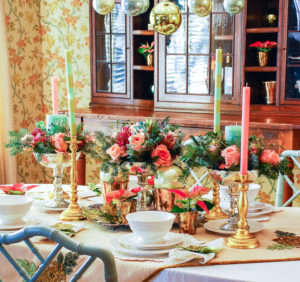 Embrace the unexpected this holiday season with a whimsical-glam Christmas table bedecked with mixed metals, pink and green hues, Arté Italica dinnerware, poinsettia, and fanciful ornaments.