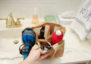 Repurpose grocery store wine totes as storage caddies to organize your closet, bathroom, and suitcase!