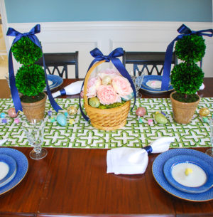 Set a bright and colorful Easter tablescape with a blooming Easter basket and boxwood topiaries for a whimsical centerpiece + get my recipe for pesto asparagus and poached egg!
