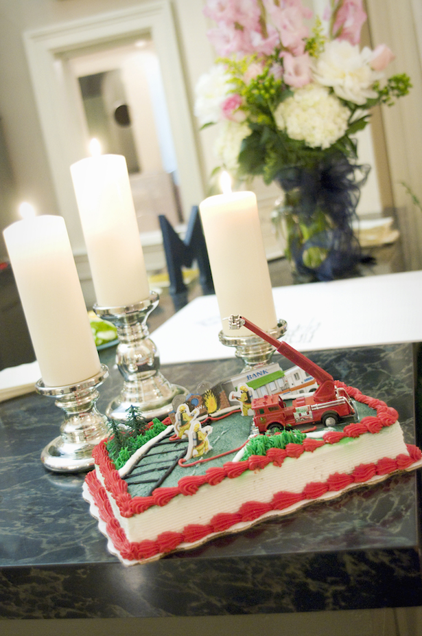 Southern wedding tradition of groom's cake decorated with firefighter toys.