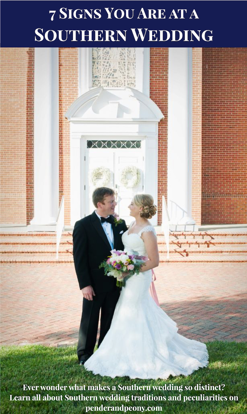Newly married couple embraces in front of church at this Southern wedding.