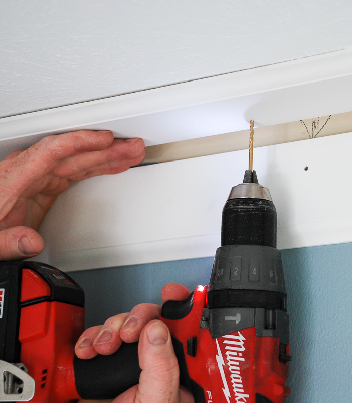 pre-drill holes to install DIY crown molding