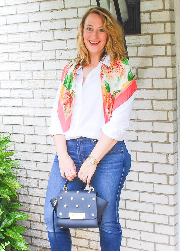 Young blond in preppy wardrobe staples: white oxford, dark wash denims, heels, and scarf.