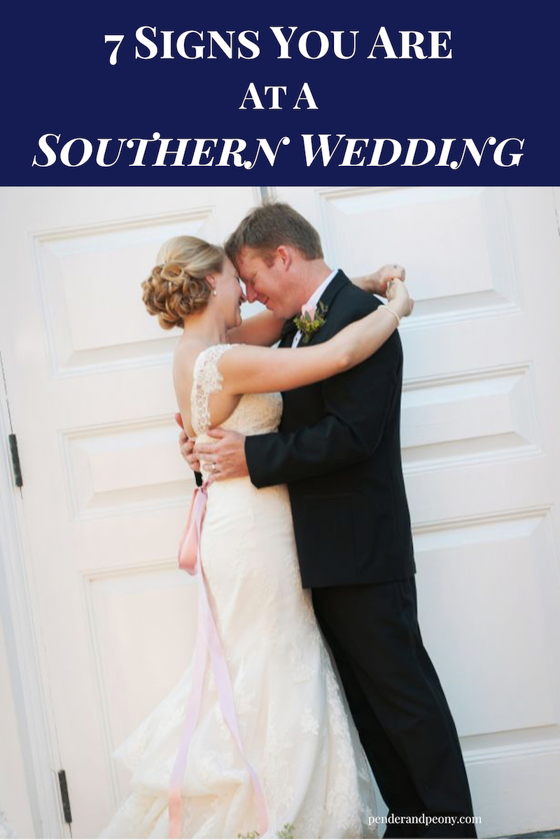 Bride and groom embrace before door at Southern wedding.