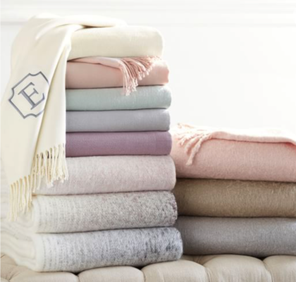 A pastel stack of throw blankets a lovely wedding gift idea!