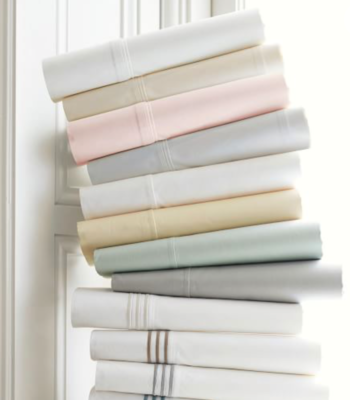 Stack of folded pretty light colored sheets the perfect addition to your wedding registry.