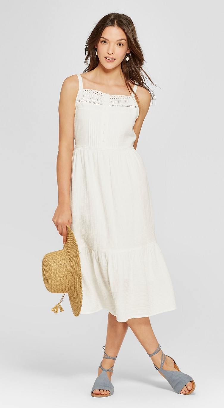 Woman wearing a white eyelet maxi dress