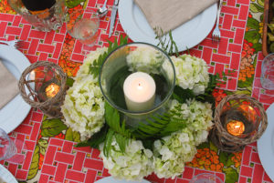 hydrangea centerpiece with glass hurricane and white candle