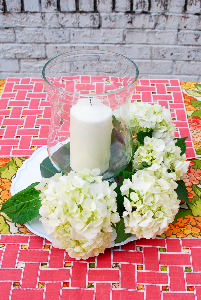 Step 6 to create hydrangea centerpiece - add hydrangea around hurricane
