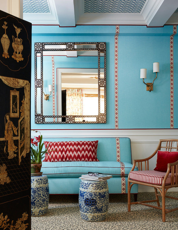 Chinoiserie chic decorating uses intense color like this sitting area in bright turquoise and cherry red.
