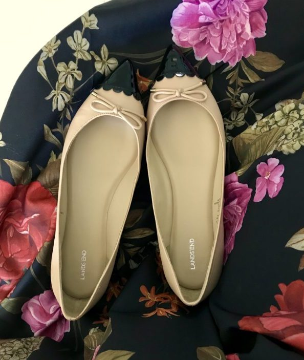 Fall fashion finds - flats laying on floral skirt