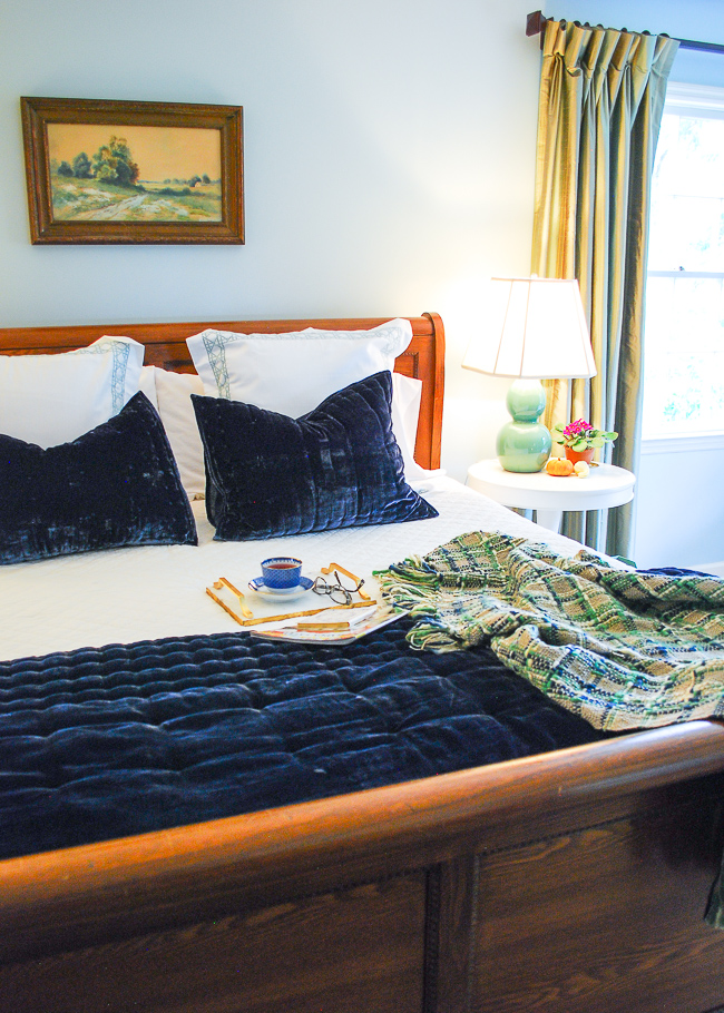 Comfy bed made with the best bed sheets from California Design Den, velvet bedding, pillow pile, and linen spray.