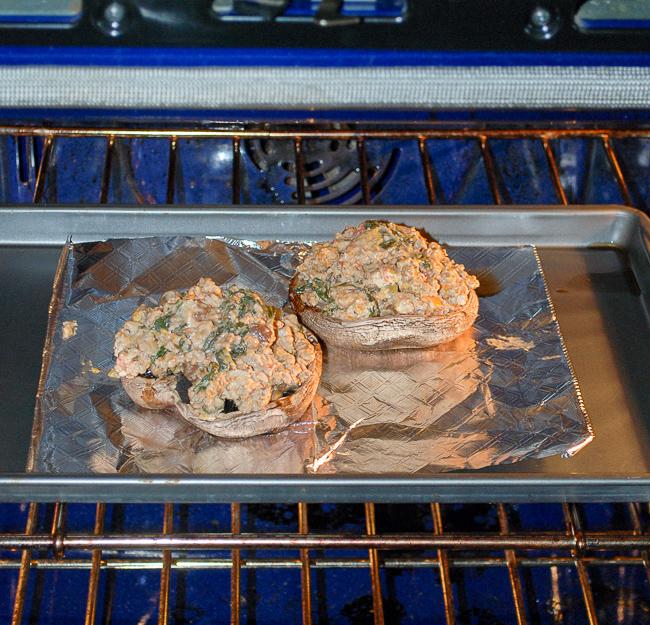 Sausage stuffed portobello mushrooms baking in oven.