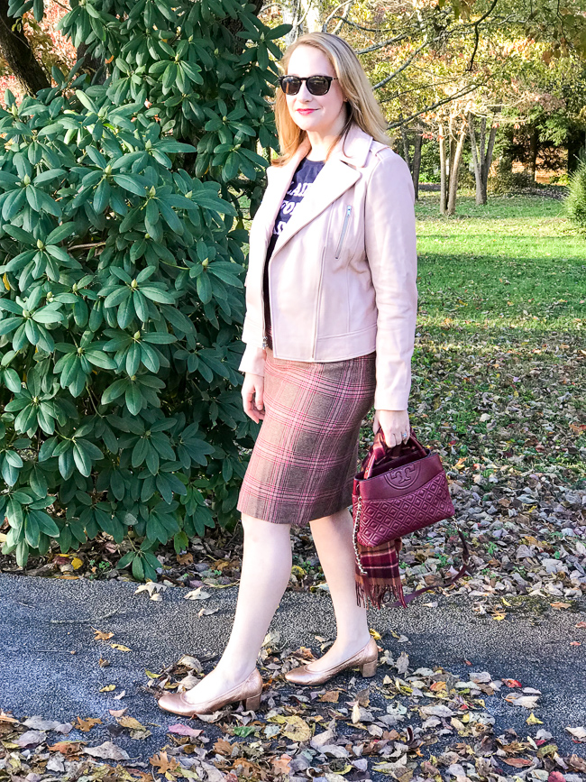 Blonde woman wearing plaid skirt - one of the 5 winter plaid pieces you need in your wardrobe