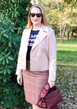 5 winter plaid pieces you need in your wardrobe - blonde woman wearing pink moto and graphic tee