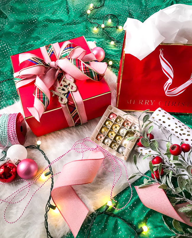 Holiday Gift Guide: Christmas presents wrapped with preppy plaid, red, ornaments, and twine.