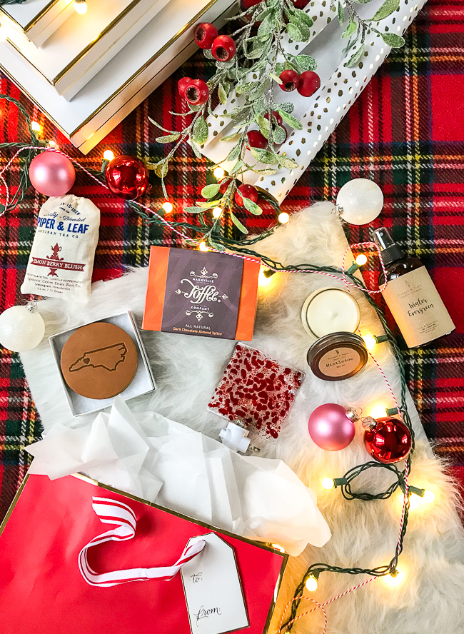 Handcrafted Christmas gifts for the host: toffee, candle, linen spray, leather coasters, tea