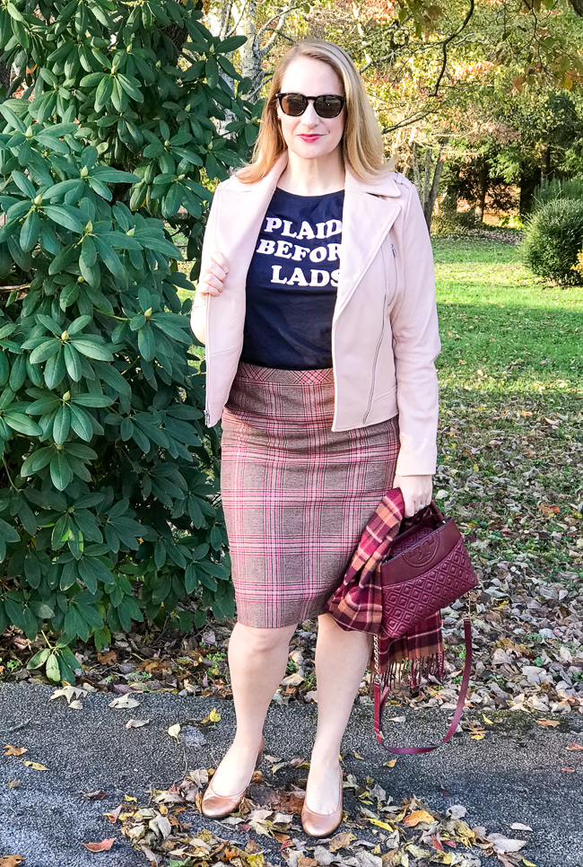 Blonde woman wearing graphic tee, plaid skirt, moto jacket for 5 winter plaid pieces you need in your wardrobe