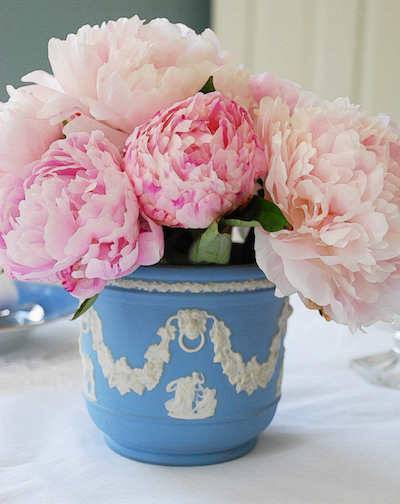 Gracious living and Southern hospitality at its finest with a Wedgewood vase filled with pink peonies.