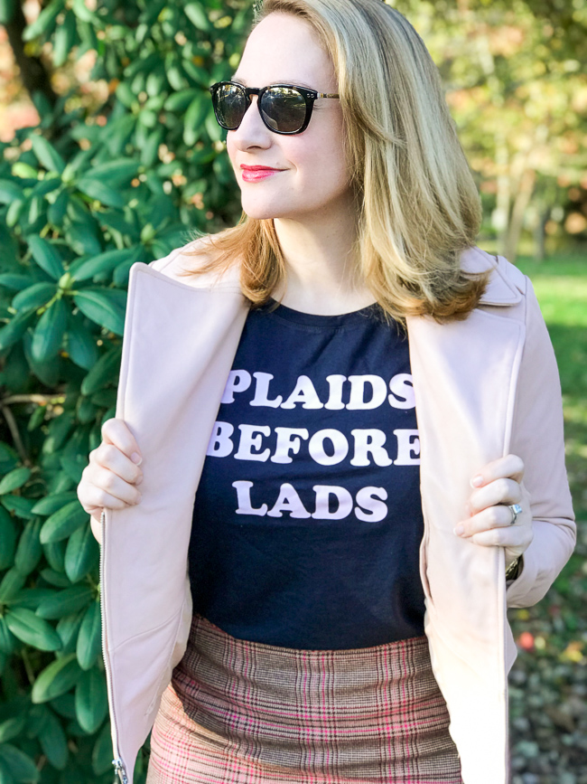 Blonde woman wearing graphic tee and pink moto jacket